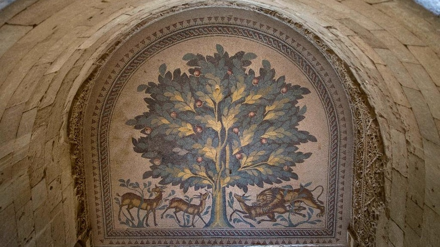 A Tree Of Life mosaic is shown at the site of a 7th century, 827 square meter (8900 square ft) mosaic ahead of the opening ceremony at the Islamic archaeological site of Hisham Palace, in the West Bank city of Jericho, Thursday, Oct. 20, 2016. A unique group of mosaics was displayed for the first time in their entirety to the public Thursday before it undergoes a US $13 million Japanese funded project to protect it and exhibit it to visitors. (AP Photo/Nasser Nasser)