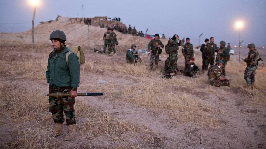 Kurdish Peshmerga forces gather prior to opening up a front against Islamic state in Nawaran, some 20 kilometers (13 miles) northeast of Mosul, Iraq, Thursday, Oct. 20, 2016. Peshmerga are launching an offensive to take the villages on the Nawaran mountain, pulling closer to Mosul. (AP Photo/Marko Drobnjakovic)