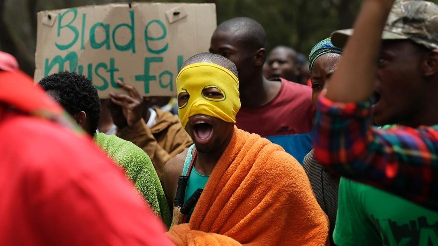 Students demonstrate downtown Pretoria, South Africa, Thursday, Oct. 20, 2016. The students were granted last minute permission to walk to the Union Building. Protests calling for free education have sometimes turned violent, and have affected many South African universities since last month. (AP Photo/Jerome Delay)