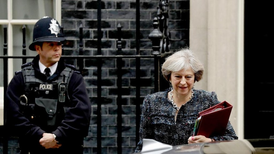 British Prime Minister Theresa May leaves 10 Downing Street in London, to attend Prime Minister's Questions at the Houses of Parliament, Wednesday, Oct. 19, 2016. (AP Photo/Matt Dunham)