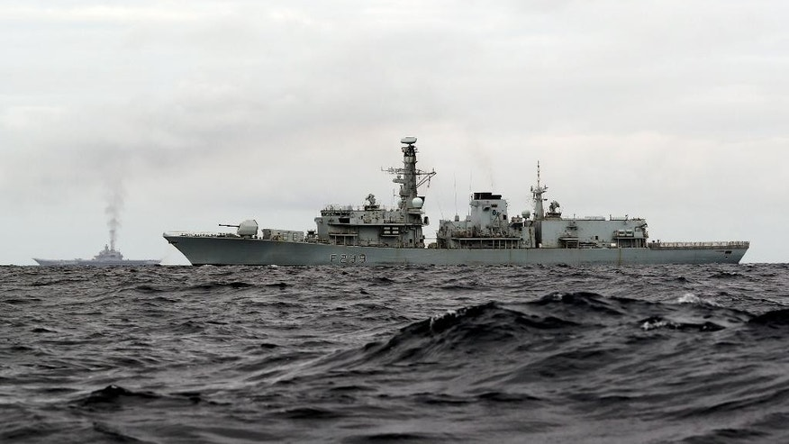 "This is a handout photo issued by Britain's Ministry of Defence taken on Wednesday Oct. 19, 2016,  of HMS Richmond, foreground,  a Type 23 Duke Class frigate, observing aircraft carrier Admiral Kuznetsov, at rear left,  which is part of a Russian task group, during transit through the North Sea. Britain is sending warships to watch a Russian aircraft carrier group and other vessels as they sail through the North Sea and the English Channel. Defense Secretary Michael Fallon says that the military will watch the ""every step of the way.'' (PO(Phot) Dez Wade/MoD/Crown Copyright via AP)"