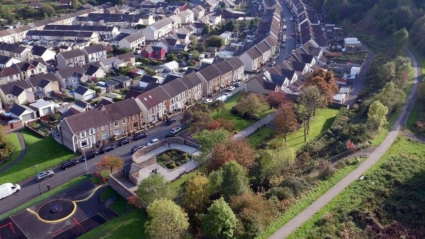 FILE - This Thursday Oct. 13, 2016 file photo shows the memorial garden dedicated to the victims of the Aberfan disaster that was built on the site of Pantglas Junior School in Aberfan Wales, as the 50th anniversary of the tragedy approaches. Fifty years ago on  Friday Oct. 21, 1966, an avalanche of mine waste swept down on a Welsh village and killed 116 children and 28 adults. Britain recalls the disaster that led to tougher rules on safety and fed a distrust of government that continues to this day (Steve Parsons/PA File via AP)