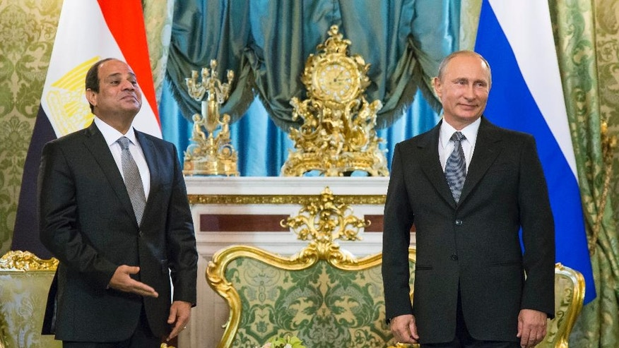 FILE - In this Wednesday, Aug. 26, 2015 file photo, Russian President Vladimir Putin, right, and Egyptian President Abdel-Fattah el-Sissi wait for their delegations during their meeting in the Kremlin, Moscow, Russia. Egypt has made fighting Islamic militants its overriding foreign policy objective, a decision that led to a series of regional realignments that have puzzled Western backers, antagonized traditional Arab allies like Saudi Arabia and brought Cairo closer to Syrian President Bashar Assad, Russia and Iran. (AP Photo/Alexander Zemlianichenko, Pool, File)