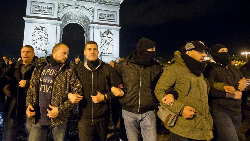 Police officers march in a rally to protest their working condition at the Champs Elysee avenue in Paris, France, Thursday, Oct. 20 2016. 500 police officer went to the street to protest the lack of equipment and rising anti-police violence in France. The Arc de Triomphe in the background. (AP Photo/Michel Euler)