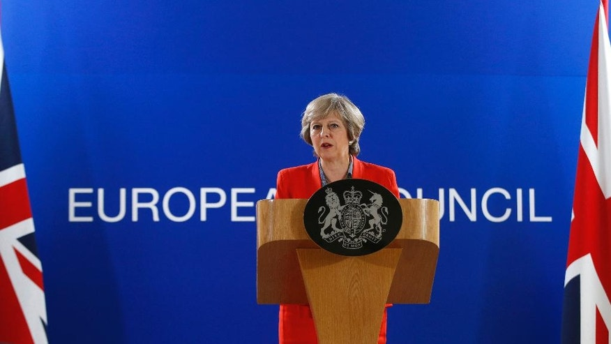 British Prime Minister Theresa May answers a question from the media during the final press briefing at the EU Summit in Brussels, Friday, Oct. 21, 2016. Prime Minister Theresa May signaled Friday that Britain is paving the way for trade talks with other countries well before it leaves the European Union but sought to reassure partners that this would not undermine the bloc's trade aims. (AP Photo/Alastair Grant)