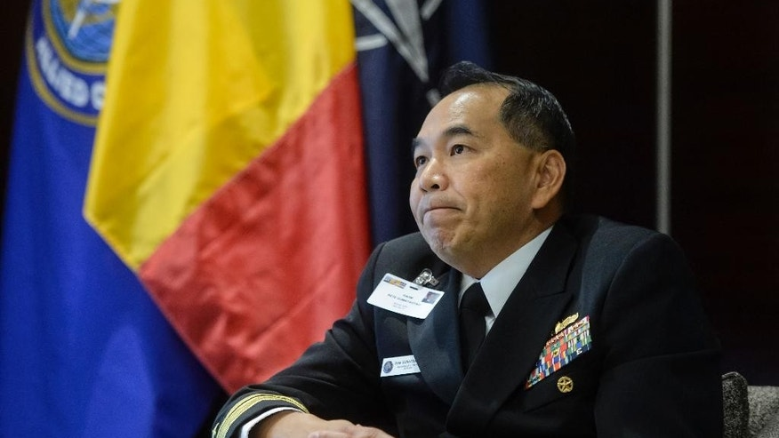 Rear Adm. Peter Gumataotao, the head of NATO Strategic Partnerships, listens during an interview with the Associated Press in Bucharest, Romania, Friday, Oct.21, 2016. Gumataotao said, speaking at a two-day NATO Strategic Military Partners Conference held in the Romanian capital, that the addition of cyber warfare to traditional threats means the military alliance faces a 360-degree threat.(AP Photo/Andreea Alexandru)