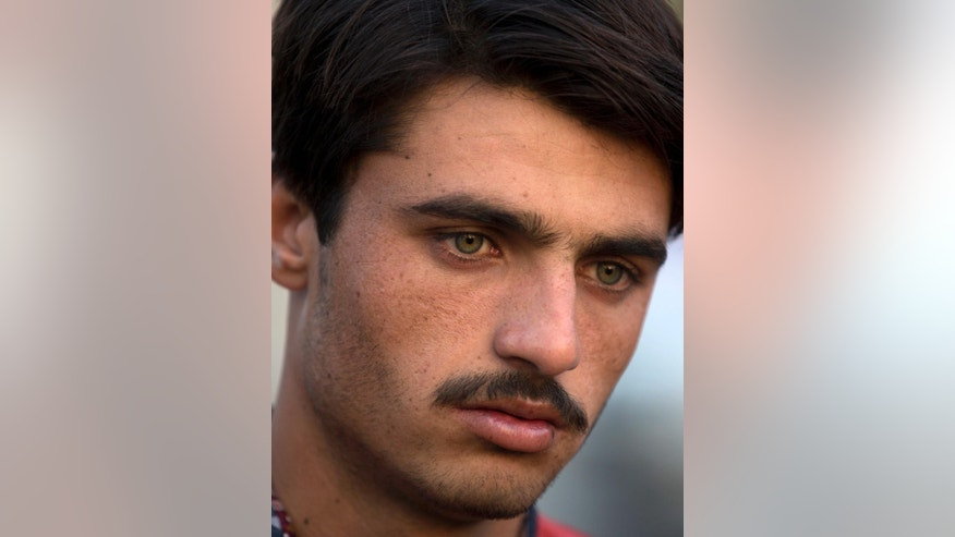 Pakistani tea vendor Arshad Khan, 18, arrives at a market where he sells tea in Islamabad, Pakistan, Friday, Oct. 21, 2016. Khan, who saw his life change overnight after a picture of him at work went viral, said Friday he was totally unaware of social media until recently when boys and girls suddenly started thronging a flea market in Islamabad to take selfies with him.(AP Photo/B.K. Bangash)