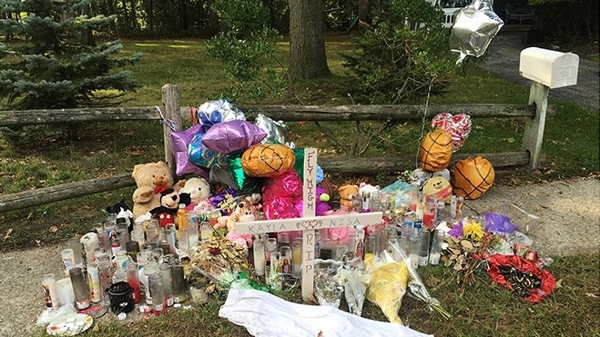 A memorial for Nisa Mickens and Kayla Cueva near the locations where their bodies were found in Brentwood, N.Y.