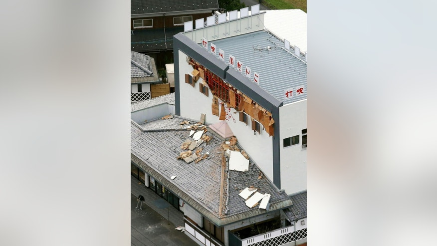 Debris fallen from damaged wall of a building are scattered on the roof following an earthquake in Kurayoshi, Tottori prefecture, western Japan, Friday, Oct. 21, 2016. A powerful earthquake with a preliminary magnitude of 6.6 struck western Japan on Friday, toppling shelves and knocking out power to thousands of homes. There was no risk of a tsunami.(Kyodo News via AP)