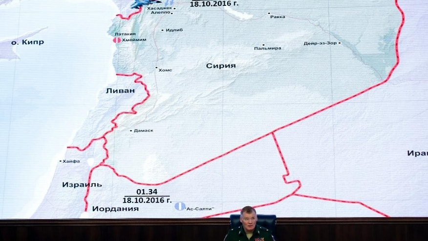 Russian Defense Ministry spokesman Maj. Gen. Igor Konashenkov speaks at a briefing in the Russian Defense Ministry's headquarters in Moscow, Russia, Thursday, Oct. 20, 2016. The Russian military is pressing its accusations against the U.S.-led coalition over a strike on a Syrian village. (AP Photo/Pavel Golovkin)