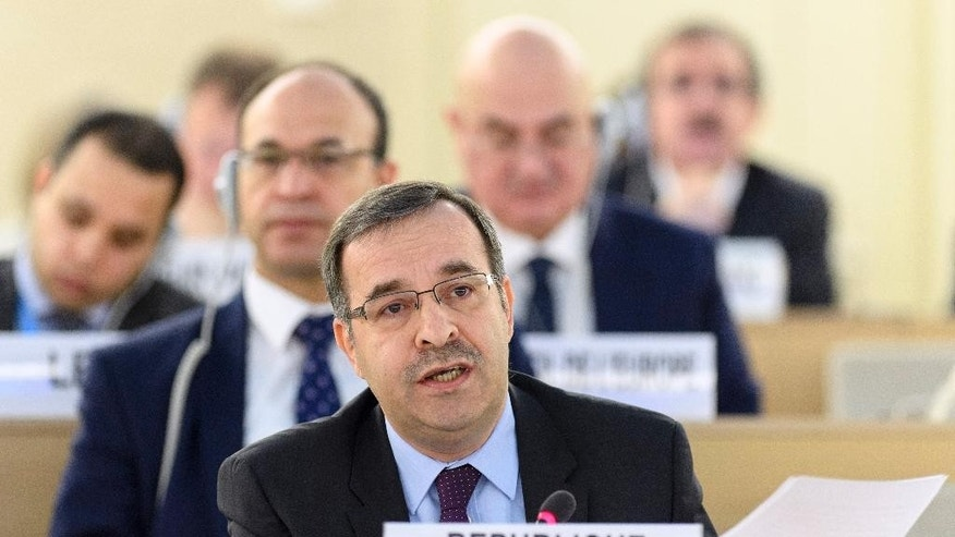 Houssam-Eddin Ala, ambassador of the Permanent Representative Mission of Syria to Geneva speaks during the Human Rights Council that holds its 25th special session on the human rights situation in Aleppo at the UN headquarters in Geneva, Switzerland, Friday, Oct. 21, 2016. (Martial Trezzini/Keystone via AP)