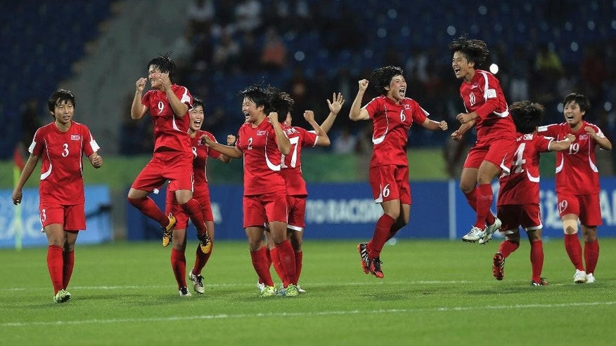 North Korea players celebrate after they won at final game of the FIFA U-17 Women's World Cup against Japan, at Amman International Stadium in Amman, Jordan, Friday, Oct. 21, 2016. The North Korean beat Japan in penalty kicks to win the 2016 FIFA U-17 Women's World Cup. North Korea defeated Japan 5:4 in a penalty shootout. (AP Photo/Raad Adayleh)