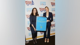 """In this image released by Starpix, actress Lynda Carter, who starred in the 1970s series,""""Wonder Woman,"""" left, and actress Gal Gadot, who stars in the upcoming film, """"Wonder Woman,"""" appear at a United Nations event naming the super hero character as an Honorary Ambassador For the Empowerment of Women and girls, Friday, Oct. 21, 2016, at the United Nations.  (Marion Curtis/Starpix via AP)"""