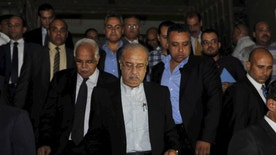 Egypt's Prime Minister Sherif Ismail (C) arrives at a morgue to check the bodies of victims of a Russian airliner which crashed early morning in El Arish, Egypt, October 31, 2015. The Airbus A321, operated by Russian airline Kogalymavia under the brand name Metrojet, carrying 224 passengers crashed into a mountainous area of Egypt's Sinai peninsula on Saturday shortly after losing radar contact near cruising altitude, killing all aboard. REUTERS/Stringer - RTX1U5XI