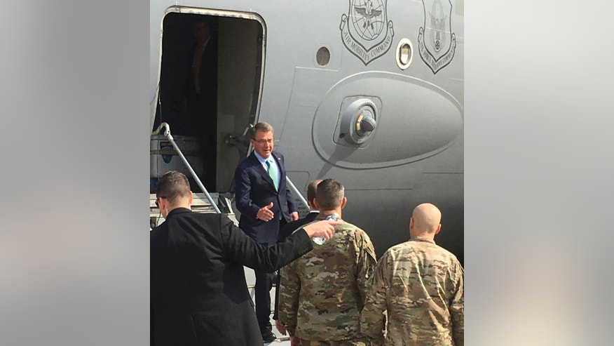 U.S. Defense Secretary Ash Carter arrives in Baghdad, Iraq to meet with his commanders and assess the progress in the opening days of the operation to retake the city of Mosul from Islamic State militants, on Saturday, Oct. 22, 2016. His visit comes two days after a U.S. service member was killed outside Mosul, underscoring the risk that American troops are taking as they advise Iraqi forces in the fight. (AP Photo/Lolita Baldor)