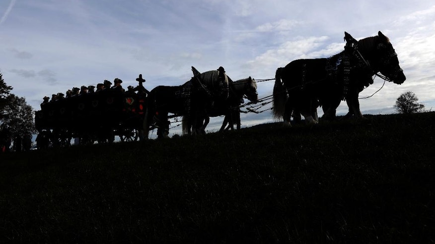 People in their traditional costumes of the region take part at the traditional Leonhardi pilgrimage in Warngau near Munich, Germany, Sunday, Oct. 23, 2016. The annual pilgrimage honors St. Leonhard, patron saint of the highland farmers for horses and livestock. (AP Photo/Matthias Schrader)