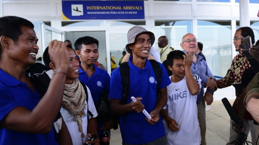 "Sailors who had been held hostage by pirates for more than four years, and were released in Somalia on Saturday, smile as they arrive at the airport in Nairobi, Kenya Sunday, Oct. 23, 2016. A Somali pirate said Saturday that 26 Asian sailors held hostage for more than four years had been released after a ransom was paid, and international mediators said it ""represents the end of captivity for the last remaining seafarers taken hostage during the height of Somali piracy."" (AP Photo)"