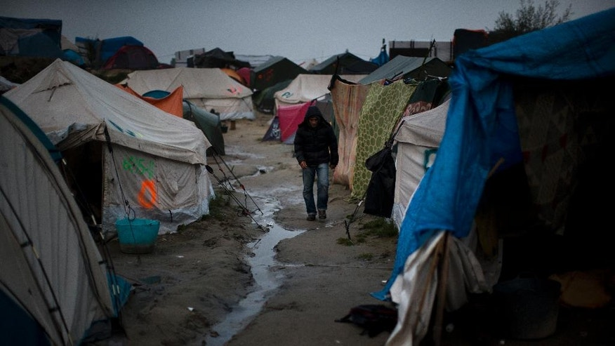 "A man walks inside a makeshift migrant camp known as ""the jungle"" near Calais, northern France, on Sunday, Oct. 23, 2016. French authorities say the closure of the slum-like camp in Calais will start on Monday and will last approximatively a week in what they describe as a ""humanitarian"" operation. (AP Photo/Emilio Morenatti)"