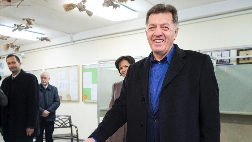 Lithuania's Social Democrat party leader and Prime Minister Algirdas Butkevicius votes at a polling station during parliamentary elections in Vilnius, Lithuania, Sunday, Oct. 23, 2016. Lithuanians are voting in an election that could see a change of government after four years of power by a ruling coalition led by the Social Democrats. (AP Photo/Mindaugas Kulbis)