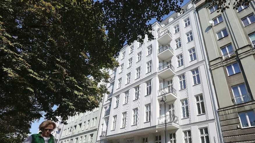 "This photo taken on Monday, Sept. 19, 2016, shows an apartment building freshly renovated by an international developer group that bought the house from the husband of Warsaw Mayor Hanna Gronkiewicz-Waltz, in Warsaw, Poland. Its previous ownership rights and its restitution to the Waltz family are one of the issues raised amid a current political storm. Poland's ruling party leader called this week for a special commission to deal with a problem that has resulted in the eviction of thousands of Warsaw residents, concerning private property that was ""nationalized,"" or seized by the communist regime in 1945, just after World War II. In recent years some of the properties have been slowly returned to their original owners or people claiming to represent them, but the process has been tainted by false claims and corruption. (AP Photo/Czarek Sokolowski)"
