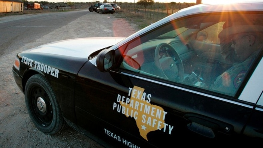 "FILE - In this April 6, 2008, file photo, a Texas State Trooper is shown sitting in his vehicle in Eldorado, Texas. Drivers in Texas busted for drunken driving, not paying child support or low-level drug offenses are among thousands of ""high-threat"" criminal arrests that officials have touted in defense of a nearly $1 billion mission to secure the border with Mexico, an Associated Press analysis has found. (AP Photo/Tony Gutierrez, File)"