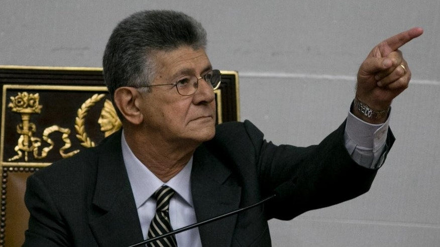 National Assembly President Henry Ramos Allup points at the beginning of a special session at the National Assembly in Caracas, Venezuela, Sunday, Oct. 23, 2016. Venezuelan lawmakers gathered at a special session to debate ways to strike back after a court on Thursday killed their chances for staging a recall referendum to throw out President Nicolas Maduro. (AP Photo/Ariana Cubillos)