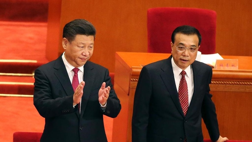 FILE - In this July 1, 2016, file photo, Chinese President Xi Jinping, left, and Premier Li Keqiang attend a ceremony to mark the 95th anniversary of the founding of the Communist Party of China at the Great Hall of the People in Beijing. Having punished more than a million Communist Party members for corruption, Xi will use a key meeting that started Monday, Oct. 24, 2016, to drive home the message that his signature anti-graft campaign is far from over and that his authority remains undiminished. The Central Committee plenary gathering also sets in motion preparations for next year's 19th national party congress that will kickoff Xi's second five-year term as head of the ruling party.(How Hwee Young/Pool Photo via AP, File)