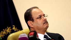"""FILE -- In this March 6, 2016 file photo, Egyptian Interior Minister Magdy Abdel-Ghaffar gives a live appearance on state and private television, in Cairo, Egypt. Abdel-Ghaffar warned of a """"conspiratorial scheme"""" by the now-banned Muslim Brotherhood to incite chaos, in comments published in state-owned newspapers Monday, Oct. 24, 2016. Abdel-Ghaffar said that the country is facing """"unprecedented challenges"""" that require a """"decisive"""" response by the police. The perceived fears come as shortages and rising food prices are feeding discontent among Egyptians, who are also enduring new taxes and a hike in utility bills. (AP Photo/Mohammed Abu Zaid, File)"""