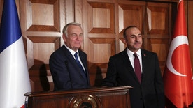 """France's Foreign Minister Jean-Marc Ayrault, left, and his Turkish counterpart Mevlut Cavusoglu shake hands after a joint news conference in Ankara, Turkey, Monday, Oct. 24, 2016. Ayrault has called for an end of the """"massive bombing raids"""" by Russia and the Syrian government forces to allow for the delivery of aid to beleaguered populations and the resumption of peace efforts in Syria. (AP Photo/Burhan Ozbilici)"""