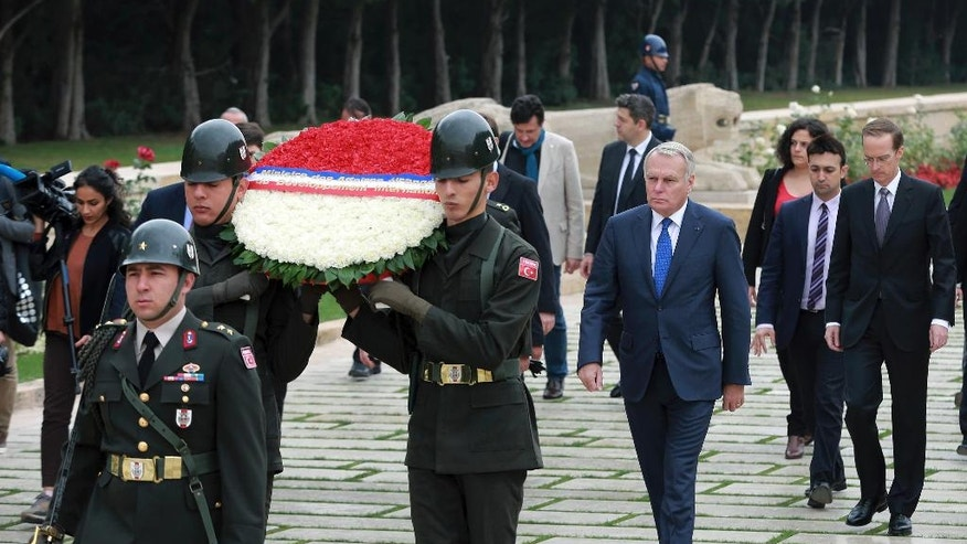 France's Foreign Minister Jean-Marc Ayrault, center, follows a military honour guard as he visits the mausoleum of Turkey's founder Kemal Ataturk, in Ankara, Turkey, Monday, Oct. 24, 2016.(AP Photo)