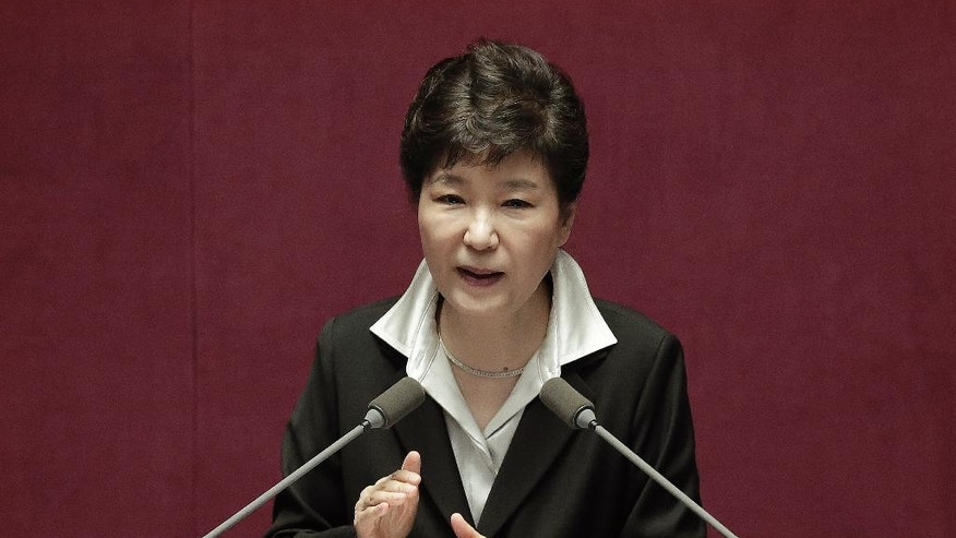 South Korean President Park Geun-hye delivers a speech at the National Assembly in Seoul, South Korea, Monday, Oct. 24, 2016. Park proposed revising the country's Constitution to change the current single five-year presidential system. Critics quickly criticized Park's overture, saying it appears aimed at diverting public attention away from a snowballing corruption scandal involving a purported longtime confidant of hers. (AP Photo/Ahn Young-joon)