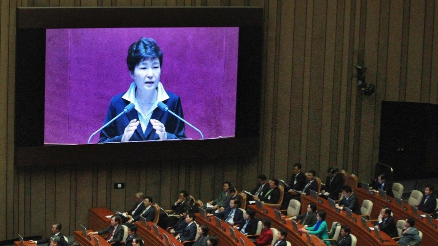 South Korean President Park Geun-hye, shown on a large screen, delivers a speech at the National Assembly in Seoul, South Korea, Monday, Oct. 24, 2016. Park on Monday proposed revising the country's Constitution to change the current single five-year presidential system. (AP Photo/Ahn Young-joon)