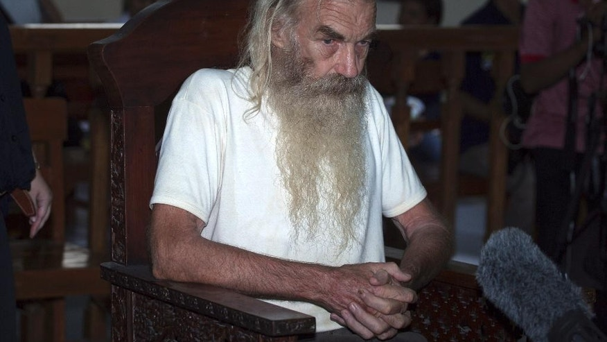 Australian retiree Robert Andrew Fiddes Ellis sits in a courtroom during his verdict trial at Denpasar District Court in Bali, Indonesia, Tuesday, Oct. 25, 2016. The court on Tuesday sentenced Ellis to 15 years in prison for sexually abusing 11 girls on the tourist island of Bali. (AP Photo/Firdia Lisnawati)