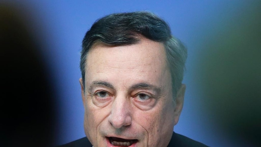 FILE - In this Thursday, Sept. 8, 2016 file photo, President of European Central Bank Mario Draghi speaks during a news conference in Frankfurt, Germany, following a meeting of the ECB governing council.  European Central Bank head Mario Draghi is defending the current low level of interest rates against charges they hurt savers and favor the wealthy. Draghi said in a speech in Berlin on Tuesday  Oct. 25, 2016 that low rates are a symptom of underlying weak investment and excess savings, which central banks must take into account.  (AP Photo/Michael Probst, File)