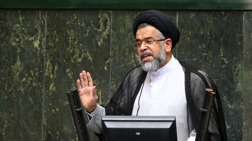 "Iranian Intelligence Minister Mahmoud Alavi answers questions from lawmakers in an open session of parliament in Tehran, Iran, Tuesday, Oct. 25, 2016. Iran's intelligence minister is defending his agents' handling of a visit by a gay Utah state senator after hard-liners alleged it represented a security breach. Alavi said Sen. Jim Dabakis was under ""full surveillance"" during his six-day visit in September. Alavi also questioned why hard-liners didn't have a problem with Dabakis making a 15-day visit in 2010 during the administration of hard-line President Mahmoud Ahmadinejad. (AP Photo/Ebrahim Noroozi)"