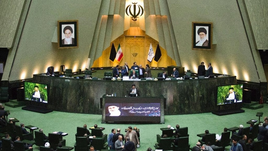 "Iranian Intelligence Minister Mahmoud Alavi, center, answers questions from lawmakers in an open session of parliament in Tehran, Iran, Tuesday, Oct. 25, 2016. Iran's intelligence minister is defending his agents' handling of a visit by a gay Utah state senator after hard-liners alleged it represented a security breach. Alavi said Sen. Jim Dabakis was under ""full surveillance"" during his six-day visit in September. Alavi also questioned why hard-liners didn't have a problem with Dabakis making a 15-day visit in 2010 during the administration of hard-line President Mahmoud Ahmadinejad. (AP Photo/Ebrahim Noroozi))"