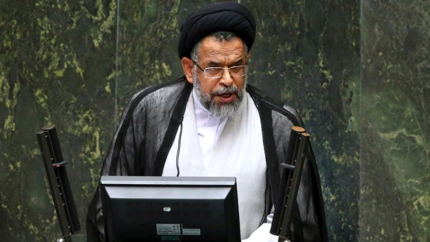 "Iranian Intelligence Minister Mahmoud Alavi answers questions from lawmakers in an open session of parliament in Tehran, Iran, Tuesday, Oct. 25, 2016. Iran's intelligence minister is defending his agents' handling of a visit by a gay Utah state senator after hard-liners alleged it represented a security breach. Alavi said Sen. Jim Dabakis was under ""full surveillance"" during his six-day visit in September. Alavi also questioned why hard-liners didn't have a problem with Dabakis making a 15-day visit in 2010 during the administration of hard-line President Mahmoud Ahmadinejad. (AP Photo/Ebrahim Noroozi))"