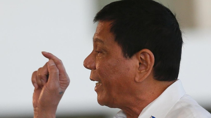 "Philippine President Rodrigo Duterte gestures during a news conference prior to boarding his flight for a three-day official visit to Japan at the Ninoy Aquino International Airport in suburban Pasay city, south of Manila, Philippines, Tuesday, Oct. 25, 2016. Duterte lashed out anew at the United States following Monday's interview with U.S. Assistant Secretary of State for East Asian and Pacific Affairs Daniel Russel who said that Duterte's controversial remarks and a ""real climate of uncertainty"" about the government's intentions have sparked consternation in the U.S. and other governments and in the corporate world. (AP Photo/Bullit Marquez)"