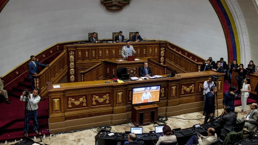 "Lawmakers hold an emergency session at Congress in Caracas, Venezuela, Tuesday, Oct. 25, 2016. After the government suspended a recall referendum seeking the president's removal last week, the opposition-controlled congress began debating Venezuelan President Nicolas Maduro's ""constitutional situation."" Lawmakers vow to present evidence that he's a dual Colombian citizen and therefore constitutionally ineligible to hold Venezuela's highest office.  (AP Photo/Alejandro Cegarra)"