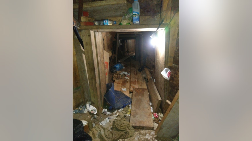 This Oct. 24, 2016 photo released by Mexico's Attorney General's Office shows a tunnel that authorities say starts in Tijuana, Mexico, and leads to the United States border. The attorney general's office did not say whether the tunnel actually reached U.S. soil. But it did say the 563-yard (meter) long passage was equipped with ventilation and lighting. (Mexico's Attorney General's Office via AP)