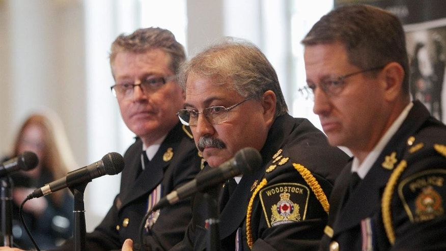 From left, Ontario Provincial Police Detective-Superintendent Dave Truax, Woodstock Police Chief William Renton and William Merrylees of the London Police give a news conference in Woodstock, Ontario, Canada on Tuesday, Oct. 25, 2016, to announce that nurse Elizabeth Tracey Mae Wettlaufer, 49, has been charged with the murders of eight elderly people at nursing homes in southwestern Ontario over a seven-year period. (Dave Chidley/The Canadian Press via AP)