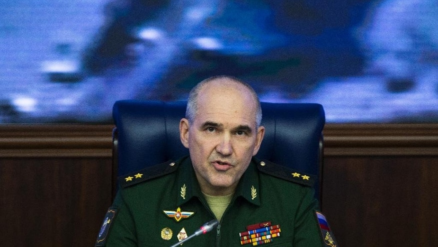Lt. Gen. Sergei Rudskoi of the Russian military's General Staff speaks at a briefing at the Russian Defense Ministry's headquarters in Moscow, Russia, Tuesday, Oct. 25, 2016. Russia's Defense Ministry said on Tuesday it was keeping humanitarian corridors out of Syria's Aleppo open following accusations by the U.N. humanitarian chief that warring parties were obstructing medical evacuations from the eastern, rebel-held districts of the city. (AP Photo/Ivan Sekretarev)
