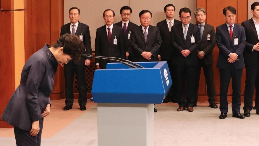 South Korean President Park Geun-hye bows after a public apology in Seoul, South Korea, Tuesday, Oct. 25, 2016. Park offered a surprise public apology after acknowledging her close ties to a mysterious woman at the center of a corruption scandal. (Baek Seung-yul/Yonhap via AP)