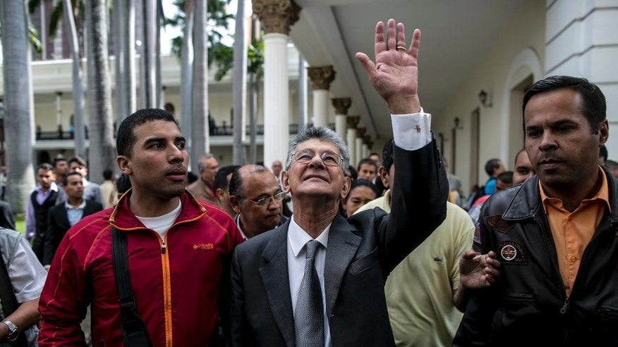 "Congressional President Henry Ramos Allup waves to supporters, after a special session of Congress a in Caracas, Venezuela, Tuesday, Oct. 25, 2016. After the government suspended a recall referendum seeking the president's removal last week, the opposition-controlled congress began debating Venezuelan President Nicolas Maduro's ""constitutional situation."" Lawmakers vow to present evidence that he's a dual Colombian citizen and therefore constitutionally ineligible to hold Venezuela's highest office. (AP Photo/Alejandro Cegarra)"