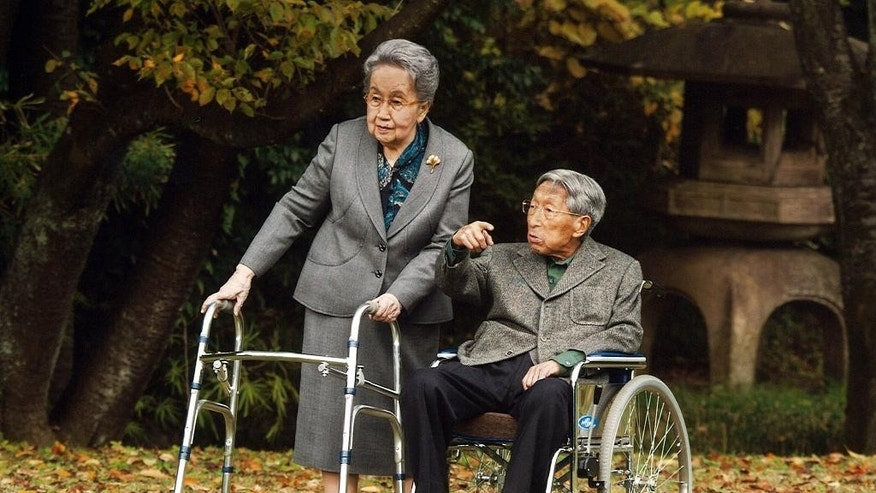 In this Nov. 16, 2015 file photo released by Imperial Household Agency of Japan,  Japanese Prince Mikasa, right, and his wife Princess Yuriko, left, talk at their residence in Tokyo. The younger brother of former Japanese Emperor Hirohito has died at the age of 100.  The Imperial Household Agency announced Thursday that Prince Mikasa died in the morning at a hospital in Tokyo.  (Imperial Household Agency of Japan via AP, File)
