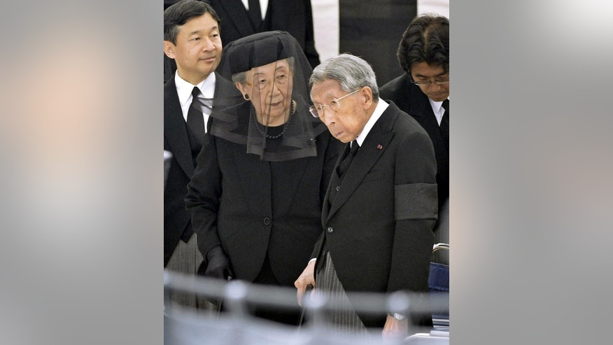 In this June 17, 2014 photo, Japan's Prince Mikasa, right, with his wife Princess Yuriko, center, and Crown Prince Naruhito, left, attends Prince Katsura's funeral service at Toshimagaoka graveyard in Tokyo. The younger brother of former Japanese Emperor Hirohito has died at the age of 100.  The Imperial Household Agency announced Thursday, Oct. 27, 2016,  that Prince Mikasa died Thursday morning at a hospital in Tokyo. (Yohei Nishimura/Kyodo News via AP)