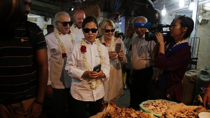 Cristeta Comerford, Chef to the President of the United States of America, third left, and other Chefs of several heads of states, visit Khari Baoli, Asia's largest spice market, in New Delhi, India, Tuesday, Oct. 25, 2016. Several chefs of Heads of States are visiting India for the Annual General Assembly of 'Le Club des Chefs des Chefs' (CCC), touted to be world's most exclusive gastronomic society, which aims to use food as a bridge between cultures and societies. (AP Photo/Altaf Qadri)