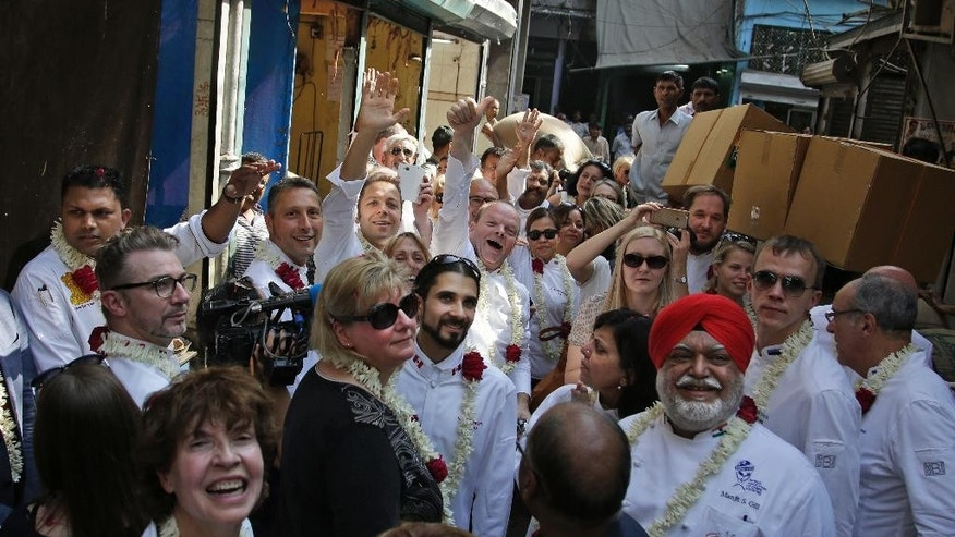 A delegation of Chefs of several heads of states visit Khari Baoli, Asia's largest spice market, in New Delhi, India, Tuesday, Oct. 25, 2016. Several chefs of Heads of States are visiting India for the Annual General Assembly of 'Le Club des Chefs des Chefs' (CCC), touted to be world's most exclusive gastronomic society, which aims to use food as a bridge between cultures and societies. (AP Photo/Altaf Qadri)