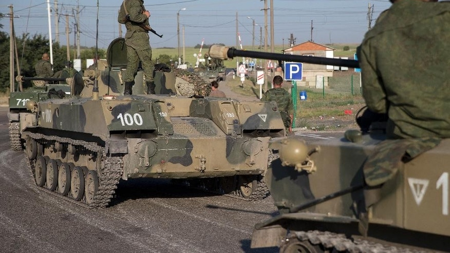 Russian solders with their military vehicles gather about 19 miles from Ukrainian border in Russia.