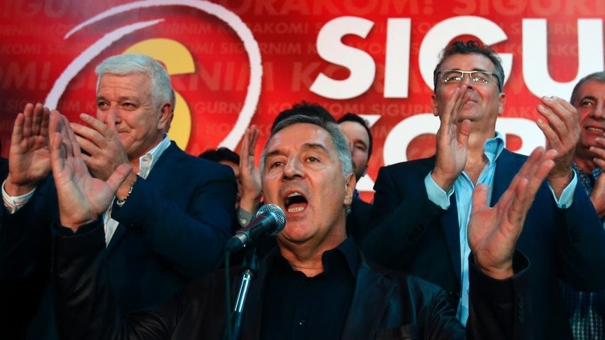 "In this photo taken Monday, Oct. 17, 2016, Montenegro's Prime Minister and long-ruling Democratic Party of Socialists leader Milo Djukanovic, speaks at his headquarters, in Podgorica, Montenegro.  Djukanovic said Tuesday Oct. 25, 2016,  ""there exists a strong connection of a foreign factor"" and suggested that Russia was involved in the Oct. 16 election vote that included the arrest of 20 people from Serbia suspected of planning violence after parliamentary election results were announced. (AP Photo/Darko Vojinovic)"
